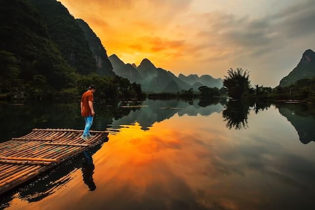 Man enjoying alone time at Yulong River