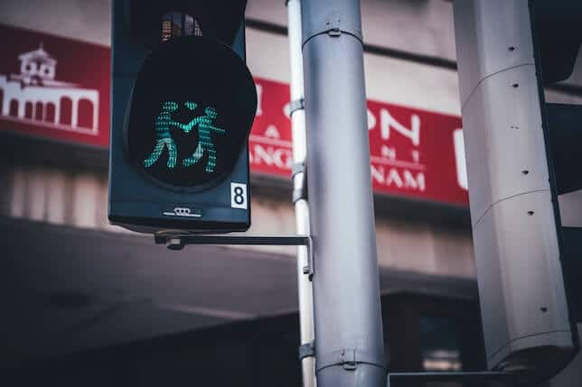 Traffic light image of two people holding hands
